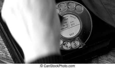 Antique Telephone bw - Woman using a vintage telephone in...