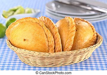 Empanadas - Peruvian snacks called Empanadas pies filled...