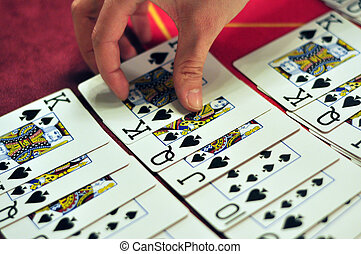 casino dealer hand working with black jack cards