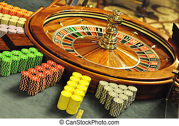 roulette wheel - casino roulette wheel with chips stacks
