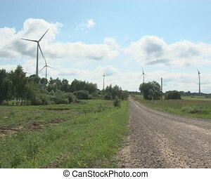 windmill rural road house - Windmills spinning. Rural gravel...