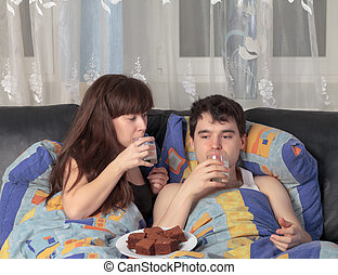 Young couple has breakfast in bed