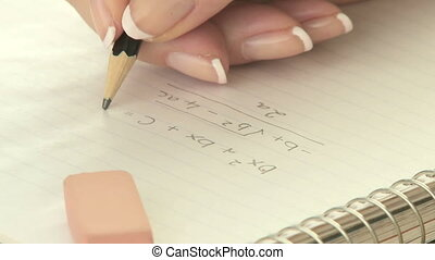 Erasing math equation - Woman erasing and correcting a math...