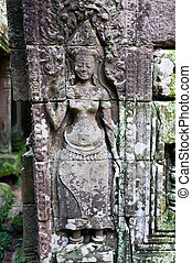 Apsara carved on the wall of Bayon Temple