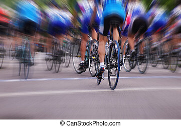 Blurred professional bike racers in a road race