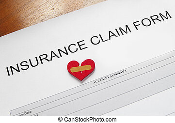 insurance claim form with bandaged heart