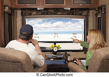 Couple Enjoy Beach View From RV - Young Couple Enjoying the...