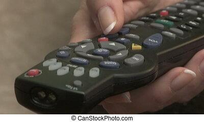 Television Remote - Woman operates TV remo