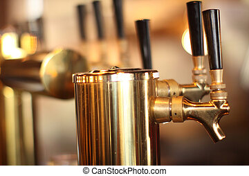 Row of beer taps in a tavern