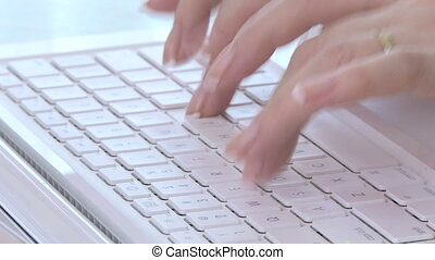 Computer keyboard - Woman working on a computer keyboard