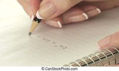 Writing math equation - Woman writing a math equation