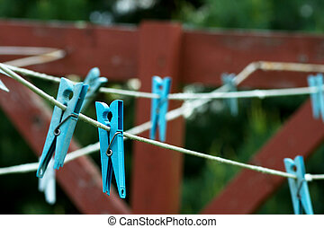 clothespins on a line - blue clothespins on a drying line...