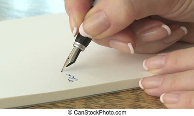 Writing with a fountain pen - Woman writing a letter with a...