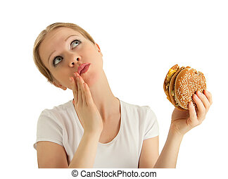 hungry beautiful girl eats a tasty hamburger an isolated
