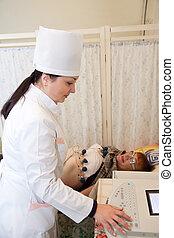 Medical doctor making ECG test