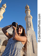 Travel photographer with digital camera at travel...