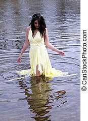 Young East Indian Woman Standing In River