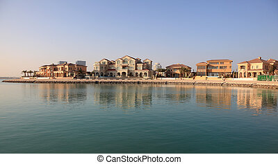 Waterside buildings at The Pearl in Doha, Qatar, Middle East