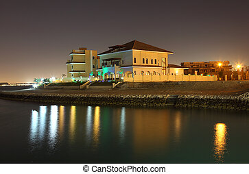 Residential buildings at night in The Pearl, Doha Qatar