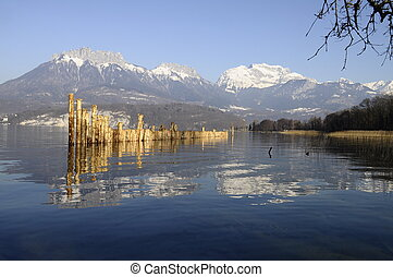 Annecy lake and mountains of Tournette and Forclaz with...