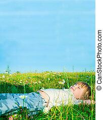child on grass