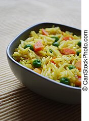 Basmati rice curry - A bowl of yellow basmati rice with...