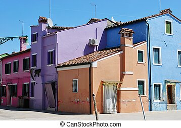 Colorful houses on the canals in Burano Island, Venice,...