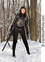 woman with a rifle in forest