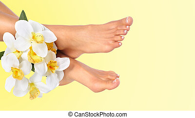Woman feet with flower. Skin care. Foot massage.