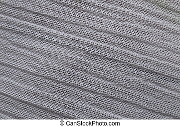 Mesh of white tissue with diagonal lines for background or...