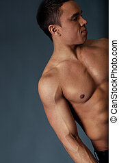 Sexy naked torso, hand and head of fit and neat young man in...