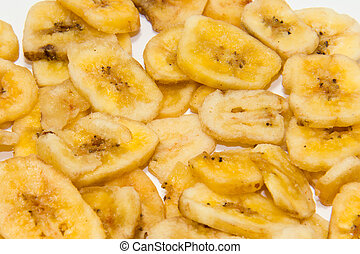 Banana chips, made from dehydrated slices of fresh ripe...