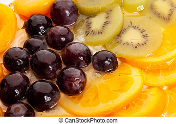 oranges, grapes, kiwi and peaches topping