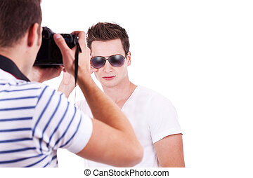 photographer taking a picture of his male model