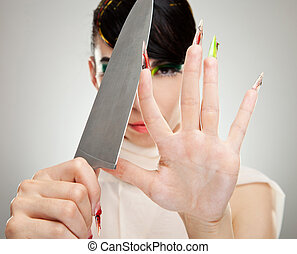 woman sharpening her nails with knife