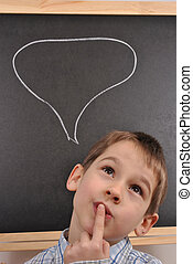 Boy is thinking - The boy is thinking by the blackboard
