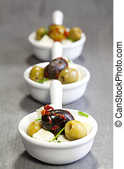 olives with feta cheese in a bowl of porcelain