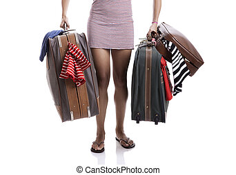 Traveller woman - Beautiful and happy young woman carying...