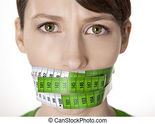 Counting calories - Portrait of a young woman with a green...