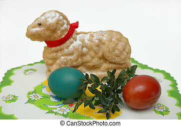 Easter eggs and lamb on decorative napkin