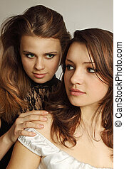 Two lesbian - Two young girls tenderly embracing each other...