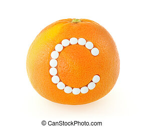 Grapefruit with vitamin c pills over white background - concept