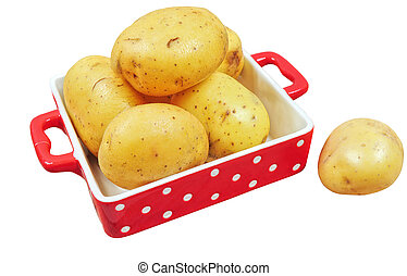 Raw potatoes in red tray, isolated