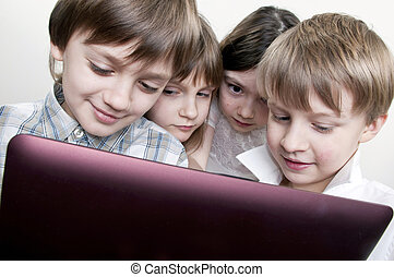 group of children friends playing computer games - group of...