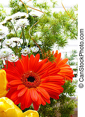 bouquet of tulips, gerberas, greenery, wild flowers, on a...