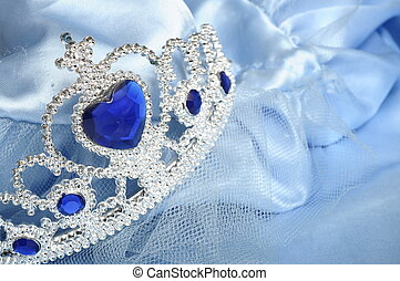 Toy tiara with diamonds and blue gem, like a princess crown,...