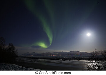 Active Northern Lights over Cook Inlet and Chugach mountains in southcentral Alaska, March 2012