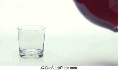 Grape Juice - Pouring grape juice into a glass