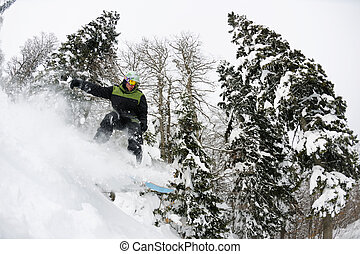 snowboarder on fresh deep snow - Snowboarder doing a jump...