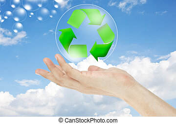 Recycle logo concept and hand